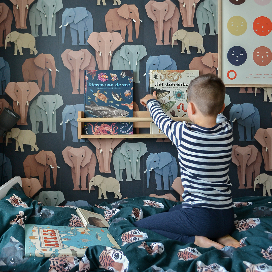 Nursery with elephant wallpaper