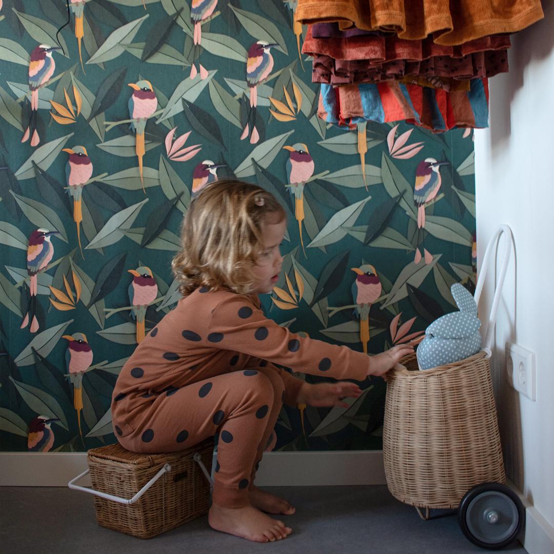 Girls room with birds wallpaper
